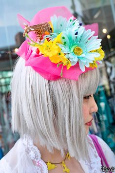Snapped this fun girl in Harajuku. Her whimsical hat features colorful flowers & a toy giraffe.