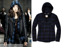 Sarah Manning (Tatiana Maslany) wears this blue plaid hooded shirt in this promo photo for Orphan Black. It is the TNA Brewster Blouse.