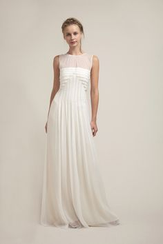 This limited edition style is unlike any other wedding dress out there. The architectural pleats are engineered by silver glass beading that are carefully placed around the pleted edges. We often call