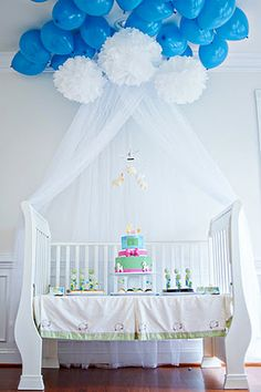 lullaby in the clouds with counting sheep baby shower dessert table on crib