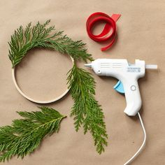 Mini-wreaths made from greenery scraps.Use the inner circle of a tiny embroidery hoop, and hot glue your greenery straight on