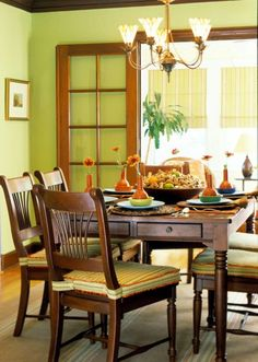 "Orange, Country Green, Soft Gold and ""warm"" furniture,  makes for comfy dining.  Like my daughter's."