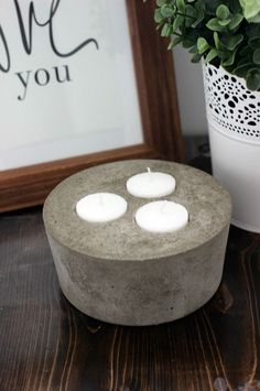I'll show you how to make a concrete candle with just a margarine dish and some tea lights! The perfect DIY decor for any rustic or industrial style!