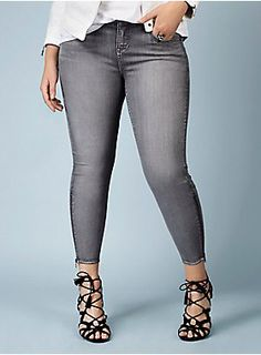 Modeled after our skinny fit, in a pewter wash that is so sleek. With a convenient five pocket design, these skinnies sport a form fit from top to bottom (all the way down to the Rebel logo zipper ankles). Rebel logo top button. Designed exclusively for Torrid by Rebel Wilson.