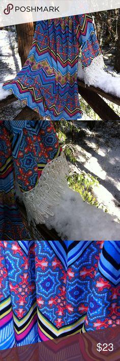 Boho peasant tunic/ mini Cali Boho nylon native print peasant tunic/ mini . Round elastic neck, 3/4 sleeve finished in large band of lace nwt, a 'Kristens Find' posh on girlfriend;) #mini dress #tunic #native print win win Tops Tunics