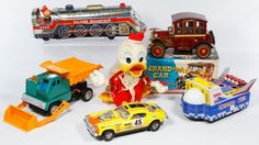 """Lot 460: Battery Operated Toy Assortment; Including a """"Grandpa Car"""" and a """"Silver Mountain"""" train made in Japan, a """"Universe Boat"""" made in China and three unmarked toys"""