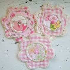 Sweet handmade fabric & felt flowers....these would look cute attached to the pillow case dresses.  :D)
