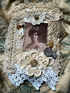 Fabric collage made with lace on a base of damask...Lovely....
