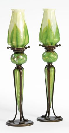 Tiffany Studios PAIR OF CANDLESTICKS SOLD. 22,500 USD They look like oil lamps to me? see burner etc