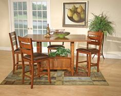 "The Breckenridge II Pub dining collection features a hunt style drop leaf table crafted of hardwood solids and and veneeers  in a cinnamon finish.  The table has 2 10"" drop leaves with tavern style storage base and extends to 34"" with 1 leaf and 44"" with both leaves.  The collection includes 4 ladder back counter stools with a polyurethane cushion."