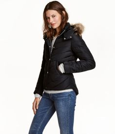Black. Lightly padded jacket with a detachable, faux fur-lined hood. Stand-up…