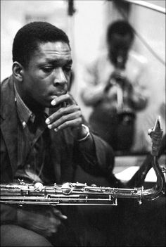 John Coltrane with Miles Davis in the background