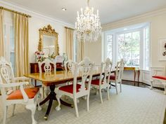 A super sophisticated dining room in white, tangerine orange, and gold.  ~ 3944 Amherst Avenue in University Park