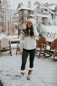 Ritz Carlton Bachelor Gulch | A Southern Drawl. White printed sweater+black leggins+brown fur lace-up boots with black details+white knit beanie+sunglasses. Winter Casual Outfit 2016-17