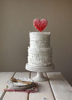 Lythwood loves this ruffled layer wedding cake. Topped with a red ruffled heart! <3 #lythwood #weddings #cake www.lythwoodweddings.co.za
