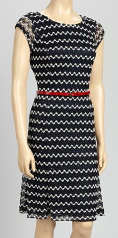 This Navy Zigzag Belted Dress fits the 2/3 rule, and widens the shoulders through the cap sleeves.