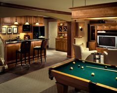 Featured in House Beautiful magazine, this home sports a place for games and media systems in this cherry ensemble.