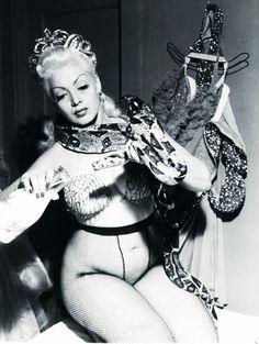 Burlesque dancer, Zorita feeds her snake 1952