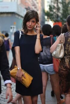 great little black dress and mustard clutch