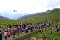 There were numerous fans along the route on the final climb.  TDF 2013 stage 19.