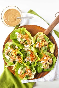 Looking for healthy and quick dinner ideas? This easy chicken lettuce wraps recipe with peanut sauce makes a delicious weeknight meal! It's healthy, refreshing, and bursting with unique flavors. Lettuce Wrap Sauce, Easy Chicken Lettuce Wraps, Asian Chicken Lettuce Wraps, Lettuce Wrap Recipes, Recipe For Lettuce Wraps, Healthy Lettuce Wraps, Homemade Peanut Sauce, Peanut Sauce Recipe, Peanut Recipes