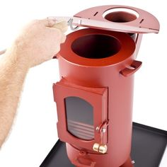 The Traveller Stove in Mojave Red. A portable multi-fuel stove. Camping Glamping, Camping Gear, Camping Tools, Outdoor Wood Burner, Best Camping Stove, Tent Stove, Stove Heater, Pellet Stove, Portable Stove