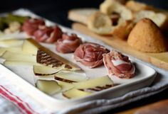 """Prosciutto Rosettes - an alternative to the """"cigar rolled"""" presentation that I usually do.  With Charcuterie Platters so popular right now, this is a quick hors d'oeuvres idea.  The trick is to twist the strand and then roll into a rosette."""