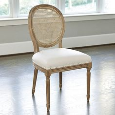 Very pretty and chic with tulip table. (different seat fabric) Louis Cane Back Dining Chair - Set of 2