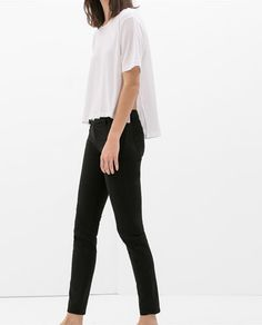 JACQUARD PATTERN TROUSERS WITH ZIPS