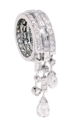 Jewelry Chaumet. Ring. This would look lovely on a pinky finger. The stones just dangling on the sides.