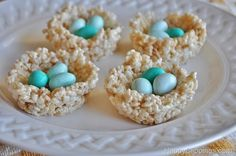 Rice Krispies Bird Nest Treats at HappyClippings.com-Rice Krispies Birds Nest Treats Recipe 3 tablespoons butter or margarine 1 package (10 oz., about 40) regular marshmallows or 4 cups miniature marshmallows 6 cups Kellogg's Rice Krispies cereal Small egg shaped candy such as chocolate eggs or jelly beans. (I used M Speck-tacular Milk Chocolate Eggs)
