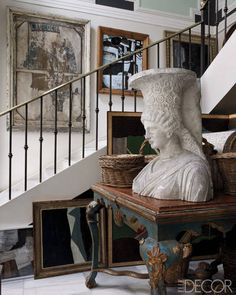 A plaster bust from the École des Beaux-Arts in Paris is displayed in the stairwell on an 18th-century table from Burgos Cathedral. I don't think I like the bust Hmmm!!