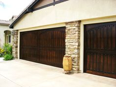 Faux wood garage doors .... beautiful! These will decently be my garage doors when I'm older