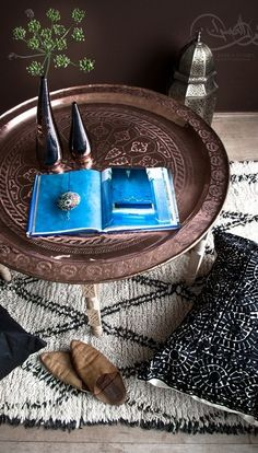 Traditional Middle Eastern style tables consist of a tray top and a foldable base for easy storage. The food is prepared in the kitchen and carried on the tray then placed over the base for serving (sometimes even without the base)-HomeSynchronize.com