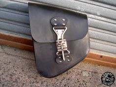 I own 2 of these bags by Garage Leathers & they are awesome!  They come in different styles and colors along w/ the hardware (nickel or brass).  Available for all Harley models.  Best part about em'... handmade in the USA!