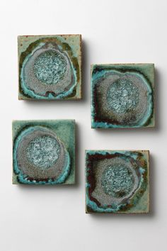 Celestial Coaster Set - Anthropologie.com  DETAILS  Glazed explosions of shimmering color, like supernovas on a delicate, dainty scale. Minneapolis potter Kerry Brooks makes each set by hand in her studio; variations from set to set are natural and make each set delightfully unique.  Set of four