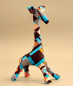 Giraffe toy pattern...looks a little tough to sew for a newbie but mistake friendly. A jumbo one would be fantastic!