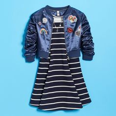 The fit and flare dress for girls with a bomber jacket are must-have pieces for back to school outfits. The bomber jacket with patches will be a daily favorite she can wear with any school outfit.