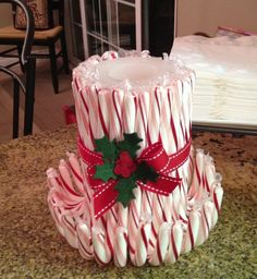 easy candy cane candle, take a candle and wrap any of your favorite candy cane flavors around it... and your done beautiful centerpiece: