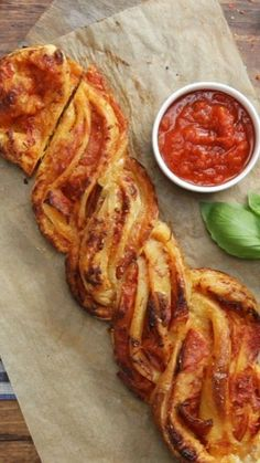 If pizza has one fault, it's that it's hard to dip. This braided pepperoni pizza bread is your delicious solution!