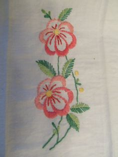 Is your kitchen or dining room decorated in a garden flower theme? Here are two vintage hand embroidered napkins to make any guest envious. These can