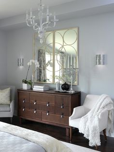Sarah Richardson:  Across from the bed, Sarah installed a glass chandelier and two sconces to add sparkle and a terrific nighttime effect to the master bedroom. Plush throws and an elegant, double-panel mirror enhance the room's glamorous ambiance.