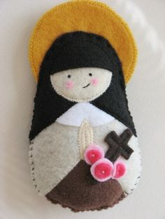 These saintly softies are awesome for baptism gifts, baptism anniversaries, first communion gifts, etc. Cecilia loves hers! And shell do custom orders even for obscure saints! Catholic Crafts, Catholic Kids, Felt Diy, Felt Crafts, First Communion Gifts, Baptism Gifts, St Therese Of Lisieux, Little Flowers, Soft Dolls