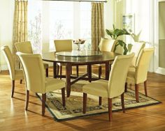 Avenue Large Dining Table by Steve Silver. $450.00. Width 72 in.. Length 72 in.. Assembly Medium Assembly Required. Height 30 in.. Weight 142.5 lb.. Transform your dining room decor and enjoy a meal in luxury with the Avenue Large Dining Table. The contemporary design of this round dining table is accentuated by its dark rich cherry finish. Comfortably seating 8 guests, this table is perfect for large families or dinner parties! Style ContemporaryMaterial W...