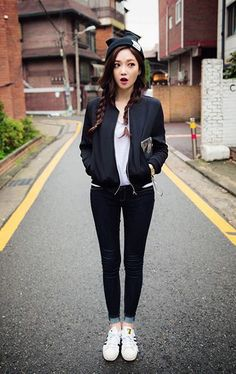 Street casual. Black bomber and black skinny jeans combo plus cute beanie and hairstyle.