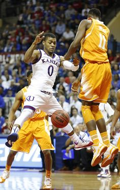 Kansas guard Frank Mason III (0) and Tennessee forward Tariq Owens (11) vie for a loose ball during the second half on Friday, Nov. 28, 2014 at the HP Field House in Kissimmee, Florida. #KU