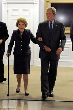 Former President George W. Bush is pictured with former First Lady Nancy Reagan at The Ronald Reagan Presidential Library in Simi Valley, California on November 18, 2010. He said:'Her influence on the White House was complete and lasting'