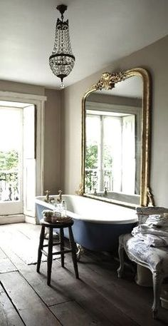 I applaud the person confident enough to have a giant mirror next to the tub. Gorgeous design though