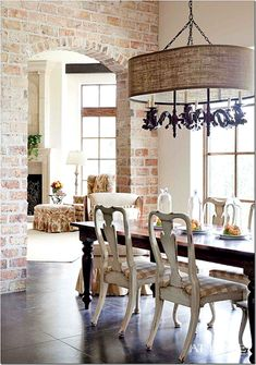 breakfast room with the French chairs in checked fabric leads to the large living room