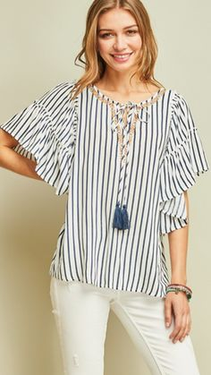 FashionGo is an online wholesale clothing marketplace where hundreds of manufacturers and wholesalers provide clothing, apparel, accessories, shoes, handbags and a variety of fashion related items. Peasant Tops, Tunic Tops, Wholesale Clothing, Spring Fashion, Personal Style, Bell Sleeve Top, Neckline, My Style, Womens Fashion